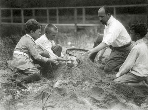 Edward Curtis with Theodore Roosevelt's children at their Sagamore Hill home on the east coast. Left to right: Quentin Roosevelt, Archie Roosevelt, Edward S. Curtis, and Nicholas Roosevelt