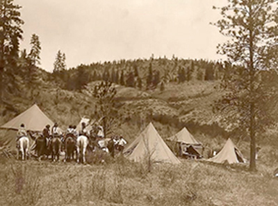 Edward Curtis with the Spokan Indian tribe at his working camp